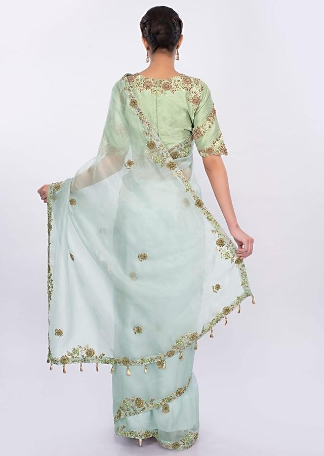 Powder blue organza saree with  contrasting pista green raw silk blouse only on kalki