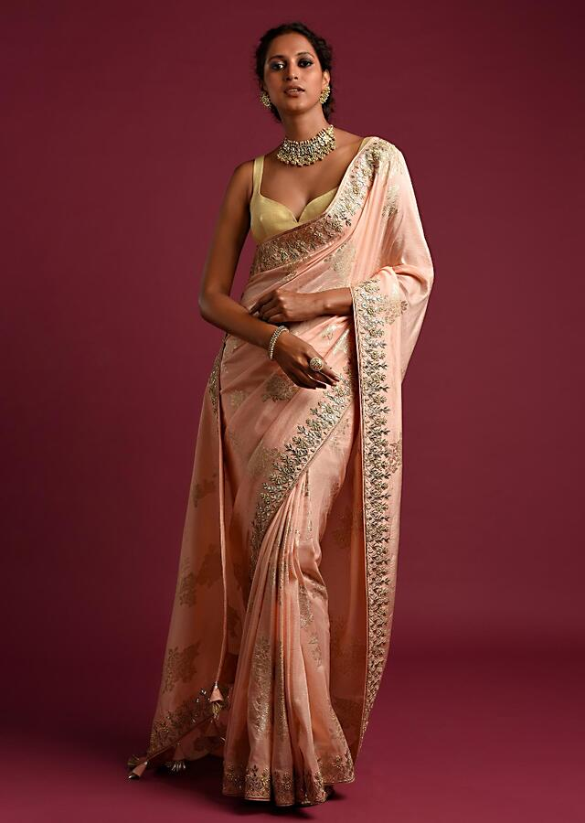 Powder Peach Banarasi Saree With Weaved Floral Motifs And Embroidered Border Online - Kalki Fashion