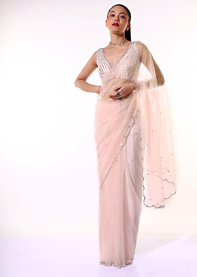 Powder Peach Saree In Net With Mirror Embroidered Scallop Cut Border And Ready Stitched Blouse Online - Kalki Fashion