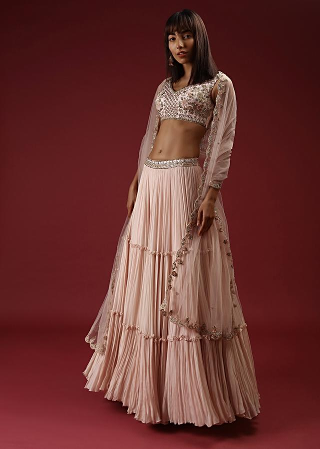 Powder Peach Tiered Lehenga With Floral Jaal Embroidered Choli Featuring Multi Colored Beads And Cut Dana Work Online - Kalki Fashion