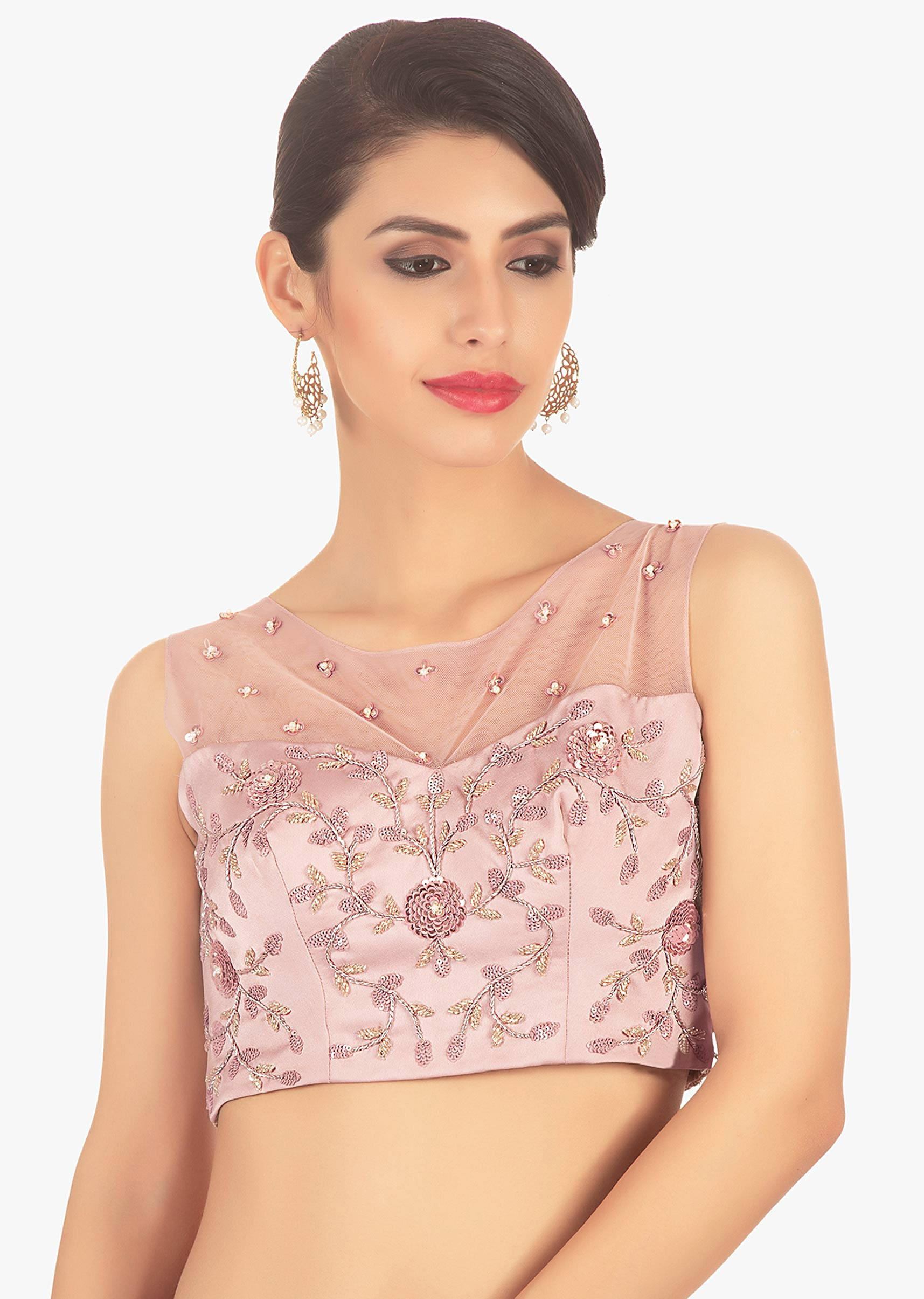 0f1ec44079f989 Powder pink crepe blouse paired with a contrasting magenta knife plated layered  skirt only on Kalki