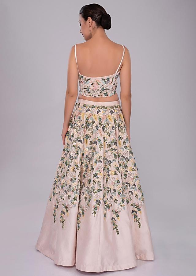 Powder Pink Lehenga With Hand And Machine Embroidery And Corset With Shoulder Cape Online - Kalki Fashion