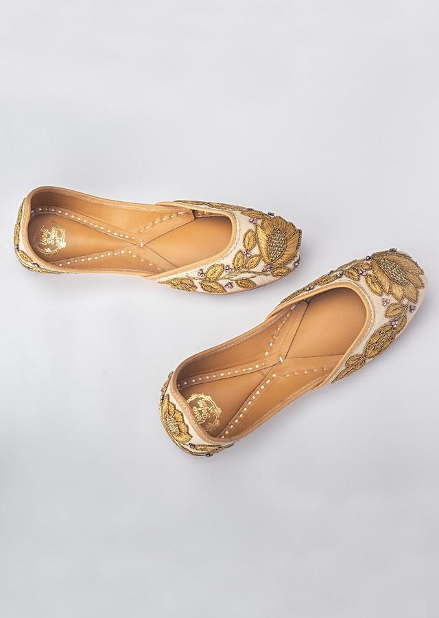 Powder Pink Juttis In Linen With Gold Resham Work, Gold Beads And A Hit Of Swarovski By Vareli Bafna