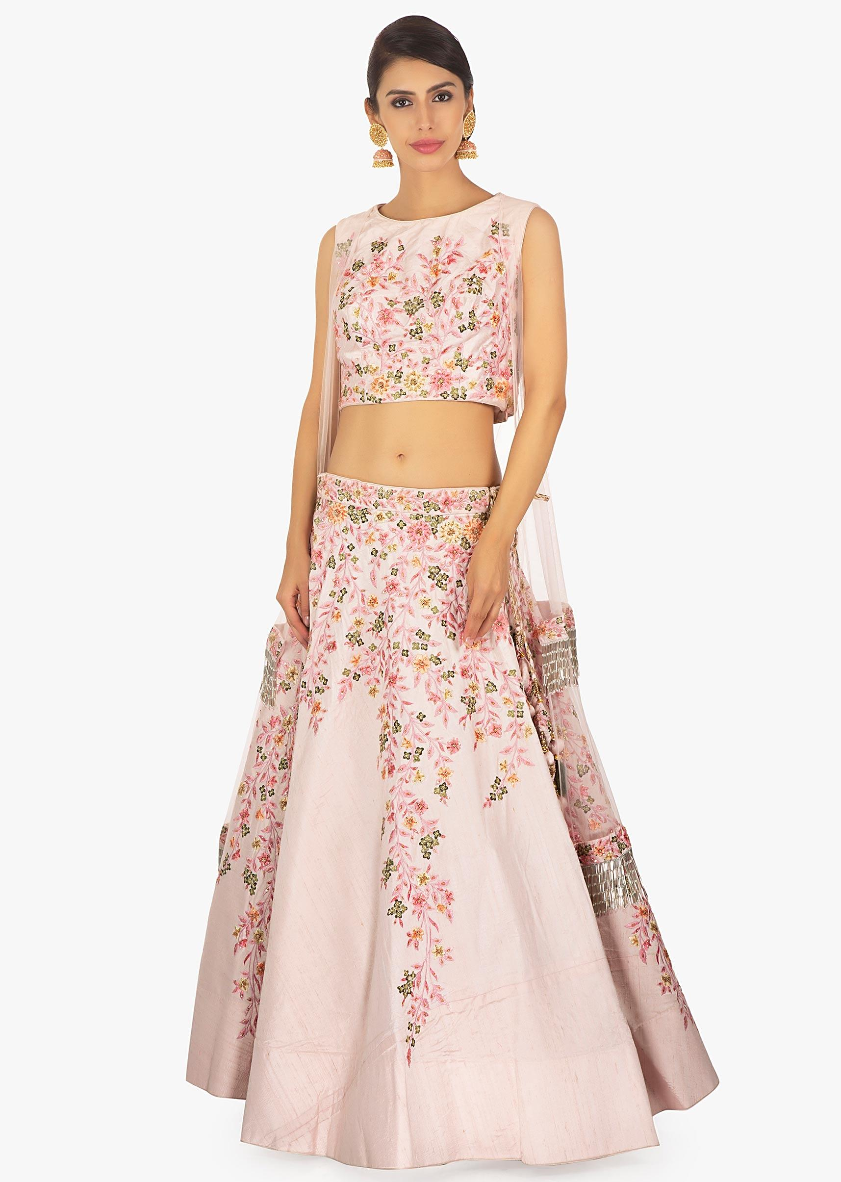 7f49eaca9a775f Powder pink lehenga paired with a matching blouse with a preattached net  jacket only on Kalki