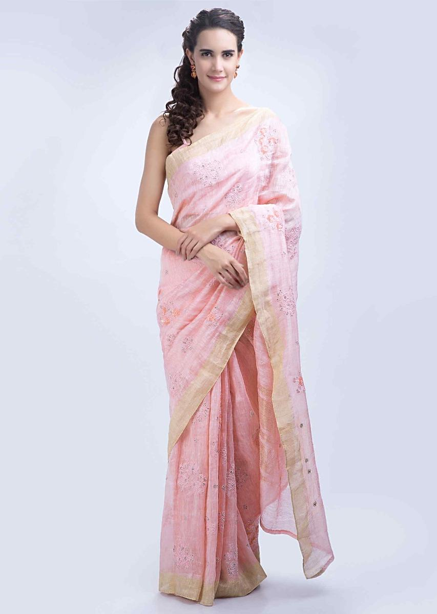 cafc134dc463f Powder pink linen saree with floral embroidered butti only on Kalki