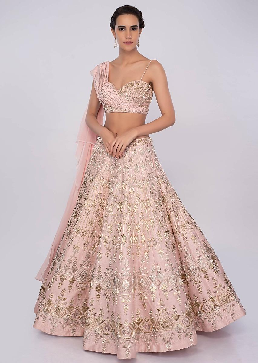Powder pink raw silk lehenga teamed with one side strap bustier with  georgette drape only on kalkiMore Detail ad6f6529f