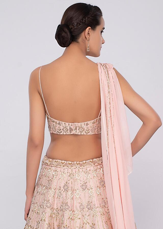 Powder Pink Lehenga In Raw Silk Teamed With One Side Strap Bustier With Georgette Drape Online - Kalki Fashion