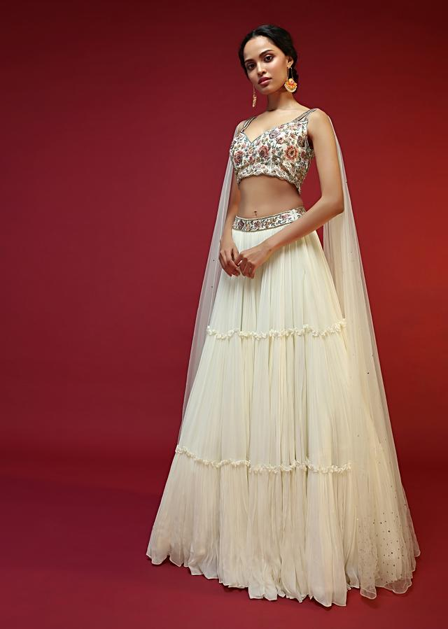 Powder White Lehenga Choli With Attached Cape And Hand Embroidery Using Colorful Resham And Sequins In Floral Motifs Online - Kalki Fashion