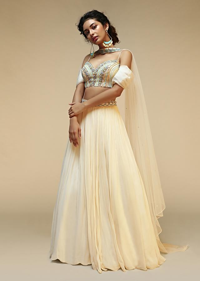 Powder White Lehenga Choli With Pleated Cold Shoulder Sleeves And Multi Colored Hand Embroidery Featuring 3D Flowers Online - Kalki Fashion