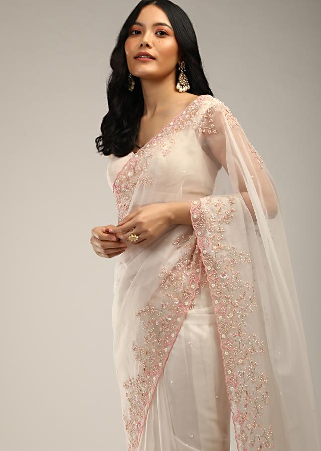 Powder White Saree In Organza With Pink And White Moti Beads Embroidered Floral Motifs On The Border Online - Kalki Fashion
