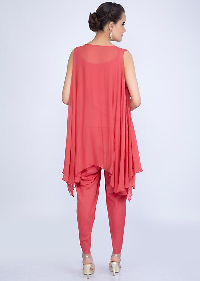 Punch pink dhoti pant with assymetric layer top  only on kalki