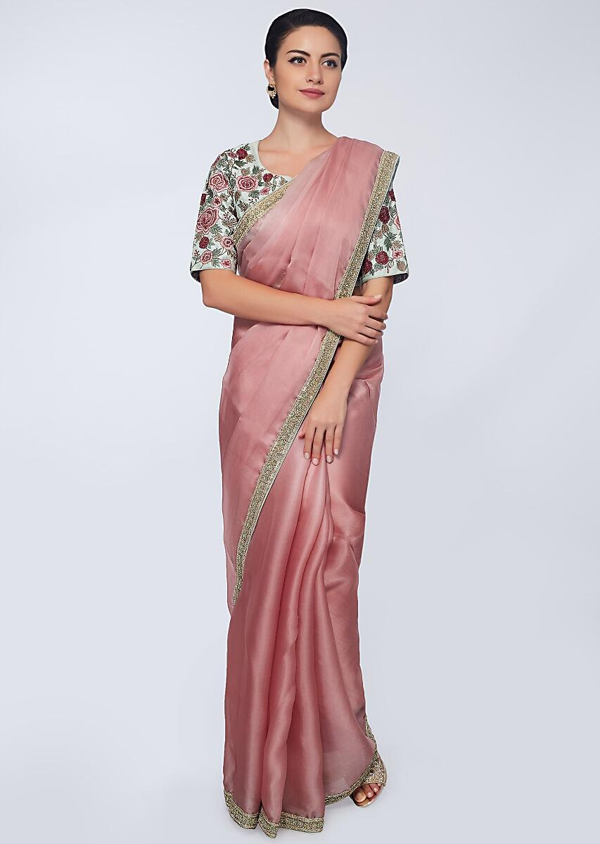 b8f1230995599 Punch pink organza saree with heavy embroidered border only on Kalki