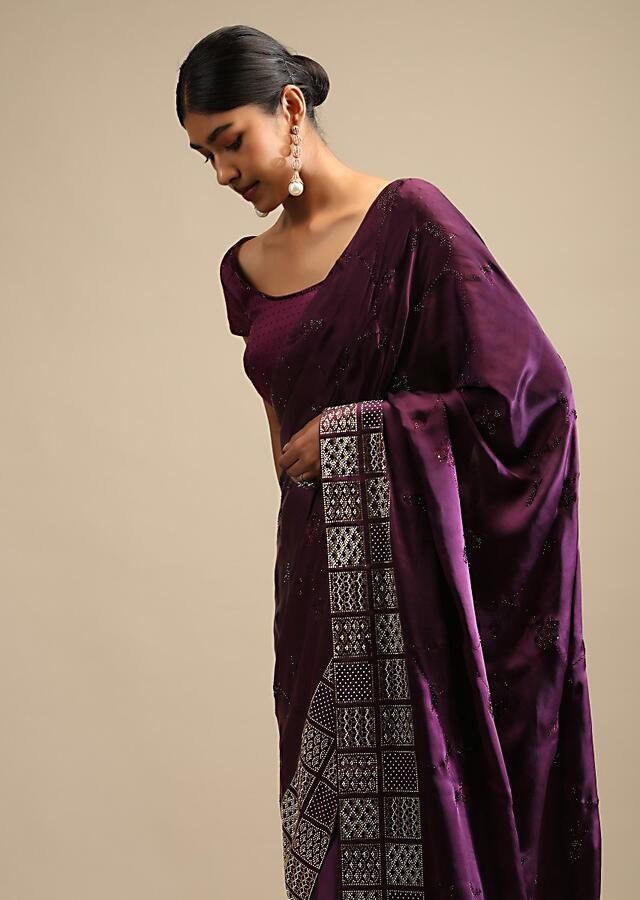 Raisin Purple Saree In Satin With Two Toned Kundan Embellished Border And Ready Stitched Blouse Online - Kalki Fashion