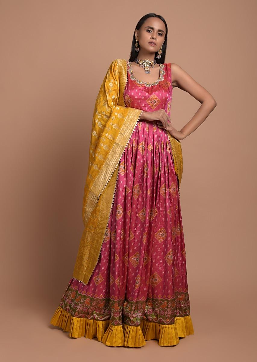 Rani Pink Anarkali Suit In Silk With Patola Print All Over And Mustard Frill On The Hem Online - Kalki Fashion
