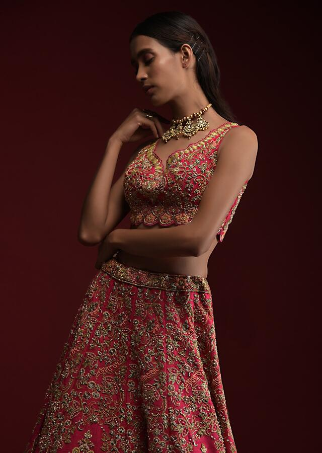 Rani Pink Lehenga Choli In Raw Silk With Hand Embossed Embroidery In Chandelier And Floral Motifs Online - Kalki Fashion