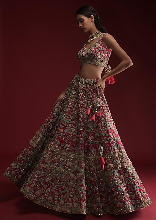 Rani Pink Lehenga Choli In Raw Silk With Heavily Hand Embroidered Heritage Floral Kalis And 3D Organza Flower Details Online - Kalki Fashion