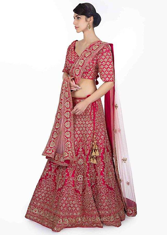 Rani Pink Lehenga In Heavily Embellished Raw Silk Paired With Embroidered Blouse And Powder Pink Net Dupatta Online - Kalki Fashion
