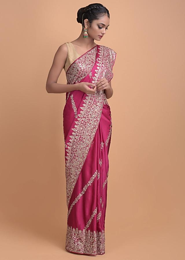 Rani Pink Saree In Satin With Zari And Sequins In Floral And Zig Zag Pattern On The Border Online - Kalki Fashion