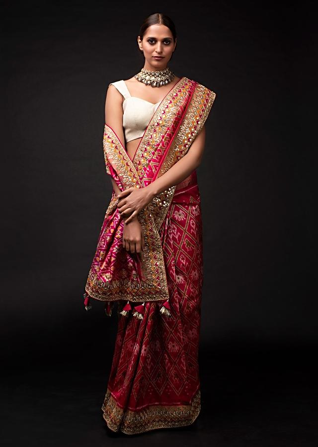 Rani Pink Saree In Silk With Ikkat Weaved Patola Pattern And Embroidery Work Online - Kalki Fashion