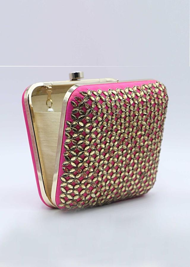 Rani pink silk hand embroidered clutch only on Kalki