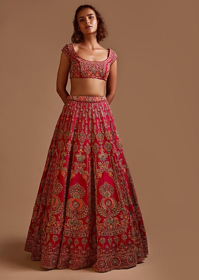 Rani Pink Lehenga Choli In Raw Silk With Colorful Resham And Cut Dana Embroidered Summertime Blossoms And Mughal Kalis Online - Kalki Fashion