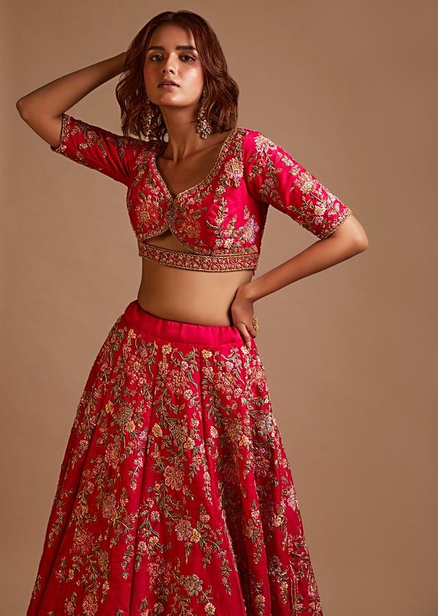 Rani Pink Lehenga Choli In Raw Silk With Hand Embroidered Cluster Of Flowers Cascading Into Floral Buttis Online - Kalki Fashion