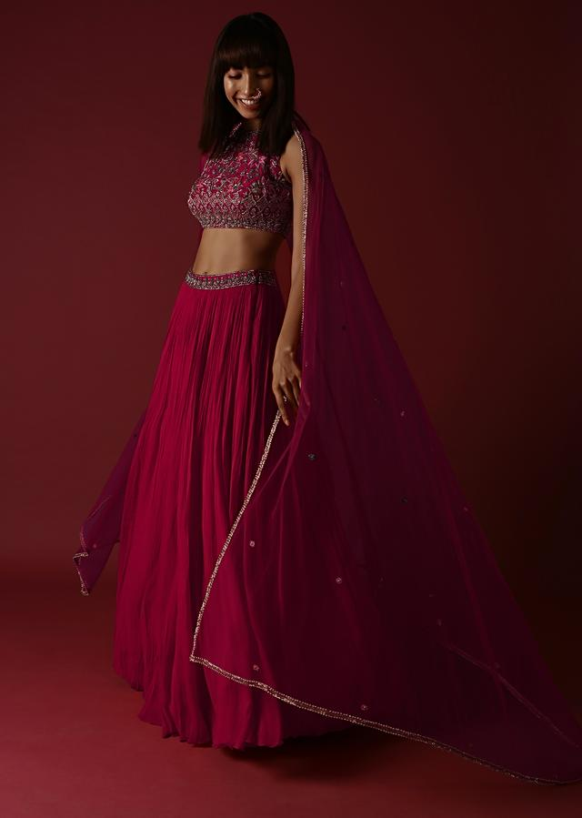 Rani Pink Lehenga Choli With Halter Neckline And Multi Colored Resham And Sequins Embroidered Flowers Online - Kalki Fashion