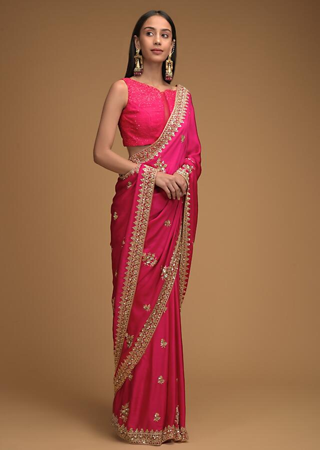 Rani Pink Saree In Satin With Hand Embroidered Floral Buttis Using Cut Dana And Sequins Work Along With Unstitched Blouse Online - Kalki Fashion