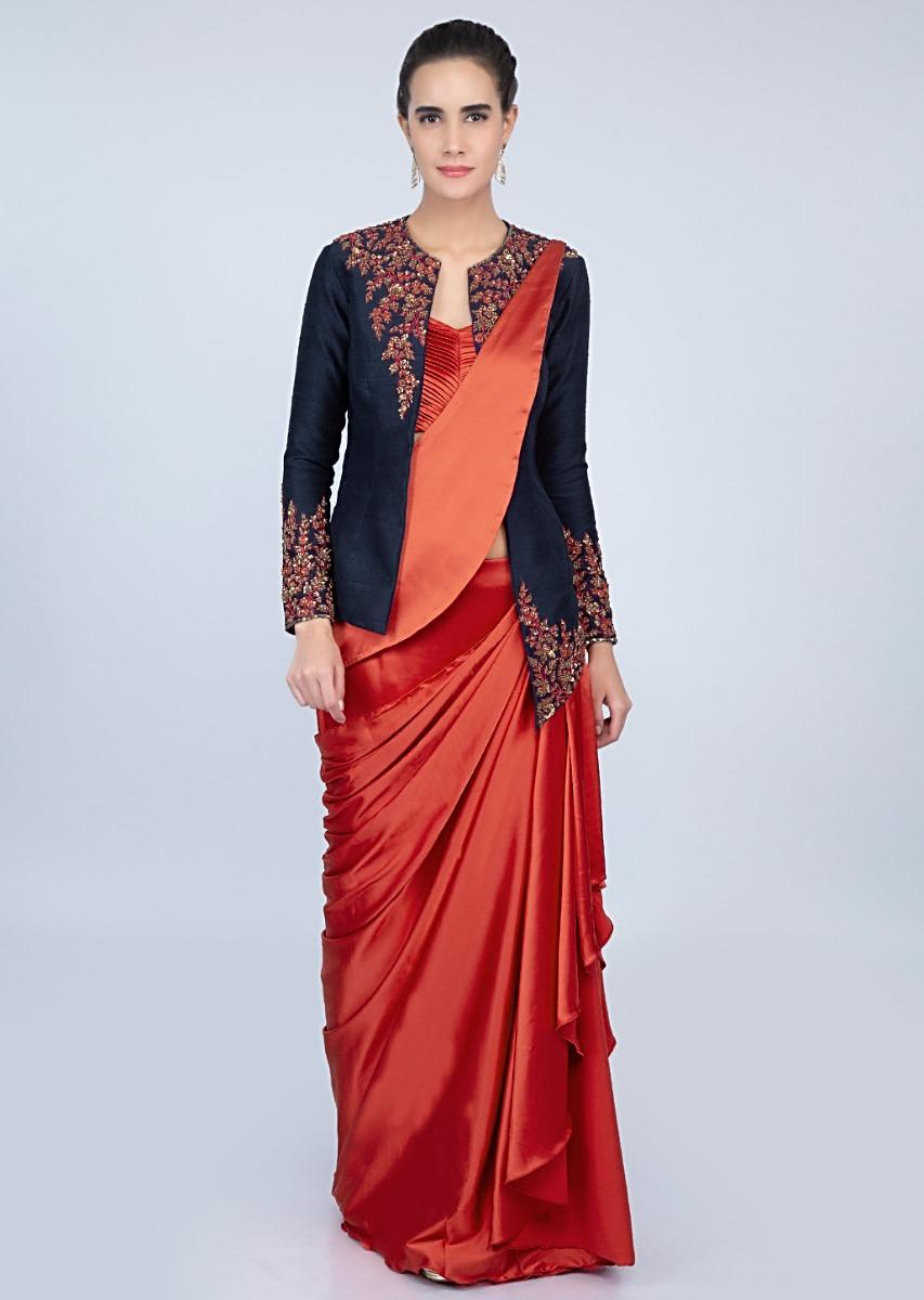 59f07dfe7d8fe2 Rebel red ready plated satin saree with pleated strap blouse and navy blue  raw silk jacket