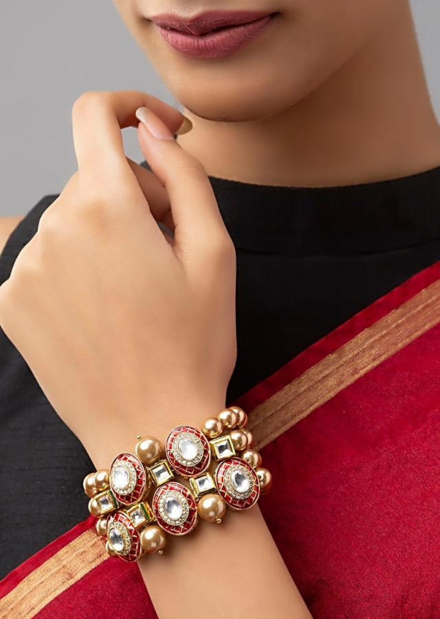 Red And Gold Bracelet With Agate Bead Strings, Swarovski Stones, Shell Pearls And Meenakari Detailing On Round Motifs Online - Joules By Radhika