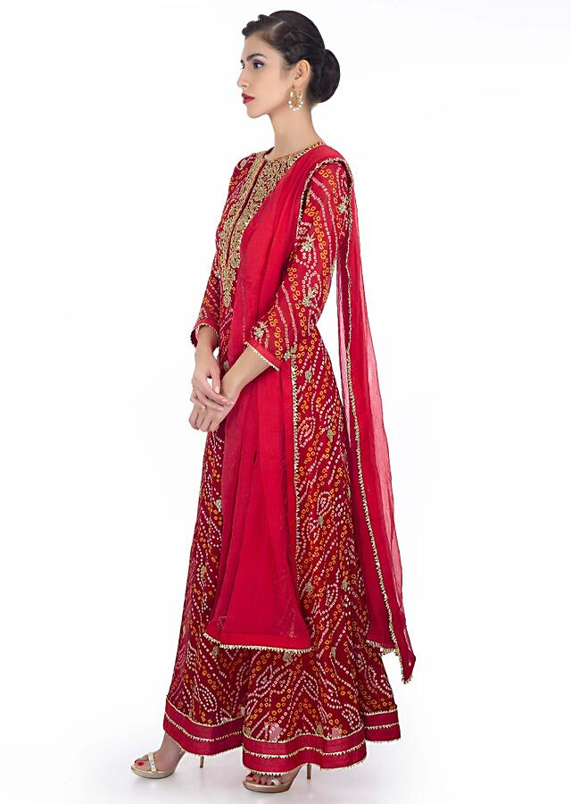 Red Anarkali Suit In Bandhani Georgette Paired With Red Chiffon Dupatta With Lace Border - Kalki Fashion