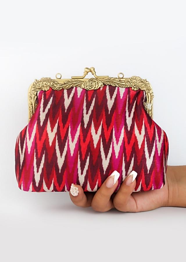 Red Clutch With Classic Ikkat Print By Vareli Bafna
