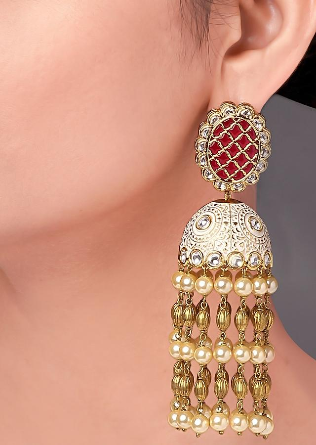 Red Jhumkas In Chandelier Design With Enamelled Pattern, Red Onyx Takkar Stones, Polki And Shell Pearls Online - Joules By Radhika