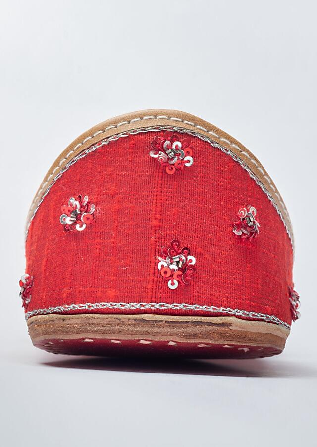 Red Juttis In Raw Silk Heavily Embroidered With Moti, Zardosi And Multi Colored Cut Dana In Floral Motifs By Vareli Bafna