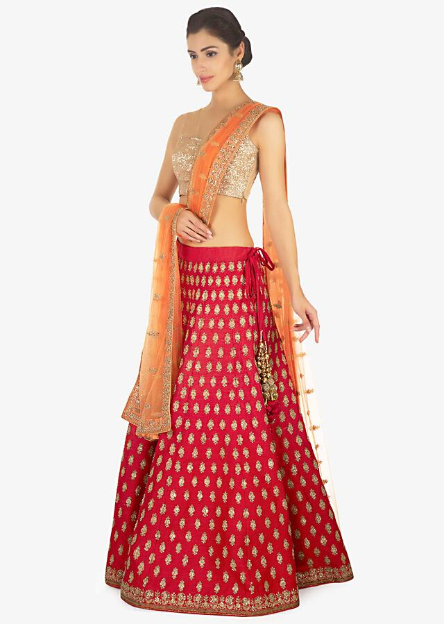 Red Lehenga And Blouse In Raw Silk Paired With A Contrasting Peach Net Dupatta Online - Kalki Fashion