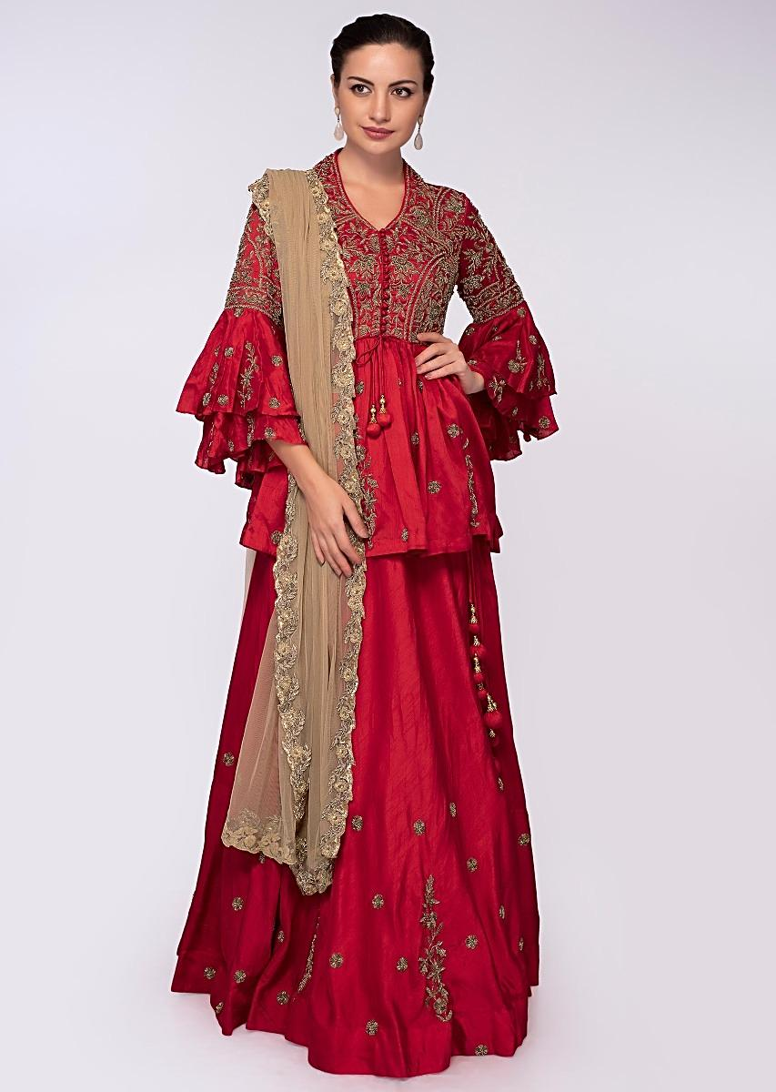 4f1b24c5eae608 Red raw silk lehenga paired with peplum style blouse only on Kalki