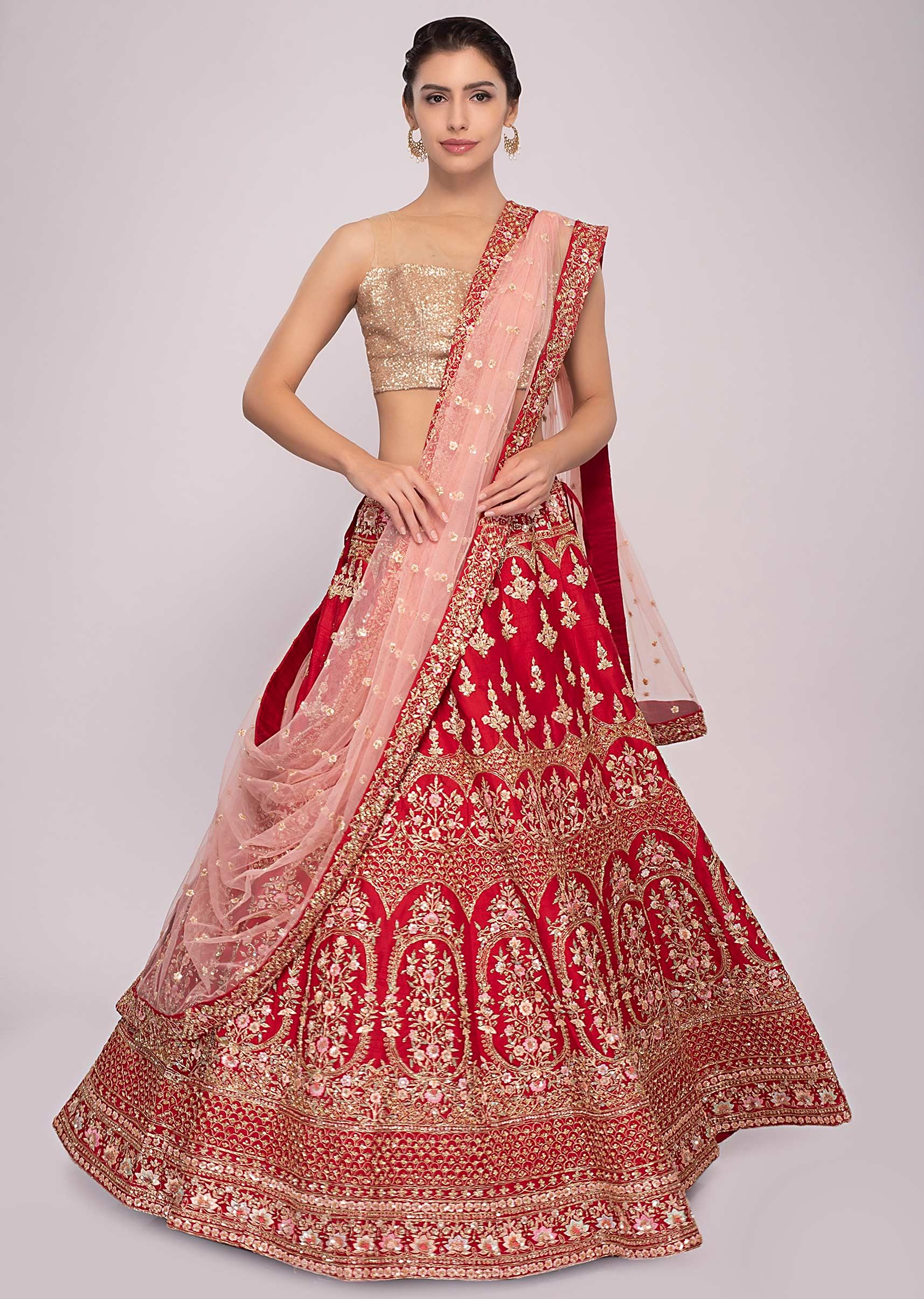 bcd043b56a Red raw silk lehenga with pink net dupatta and unstitched red blouse only  on KalkiMore Detail