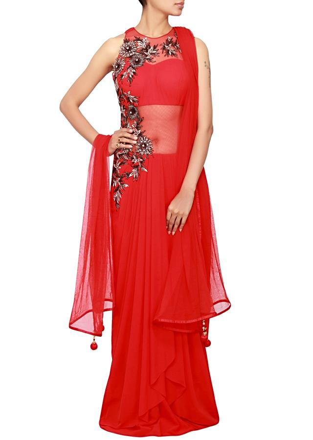Red suit in net and lycra embellished in cut-work and zari embroidery only on Kalki