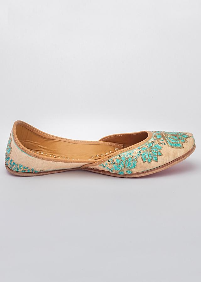 Rose Gold Juttis In Linen Hand Embroidered With Dual Coloured Resham Thread And Zari By Vareli Bafna