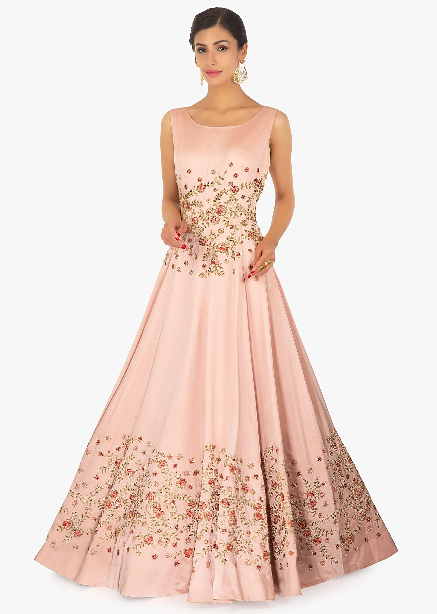Rose peach floor length gown with embellished bodice and waistline