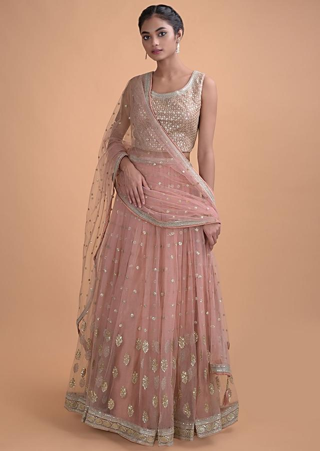 Rose Pink Lehenga In Net With Embellished Sequins And Zari Buttis In Floral And Leaf Motifs Online - Kalki Fashion