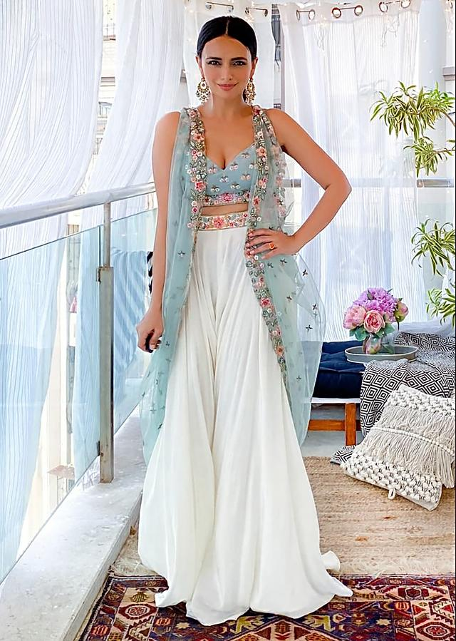 Roshni Chopra In Kalki White Palazzo Suit With A Sage Green Raw Silk Crop Top Adorned Using Vibrant Resham Embroidered Summer Blooms