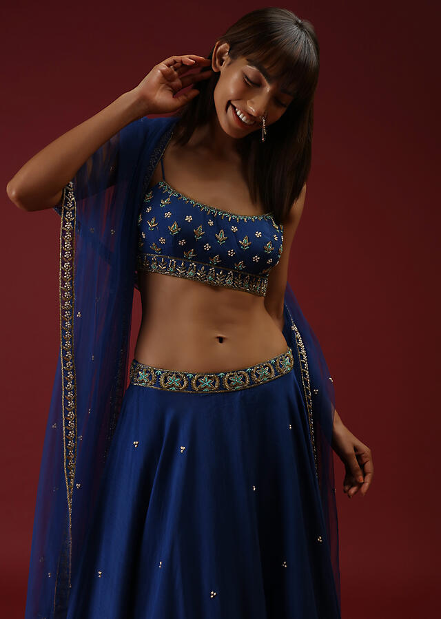 Royal Blue Lehenga Choli In Raw Silk With Hand Embroidered Butti Design Using Mint Sequins And Cut Dana Work Online - Kalki Fashion