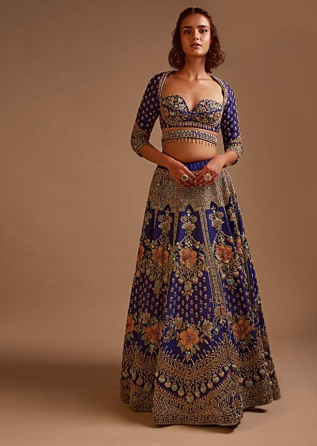Royal Blue Lehenga Choli In Raw Silk With Hand Embossed Embroidery Work In Heritage Floral Kalis And 3D Work Details Online - Kalki Fashion