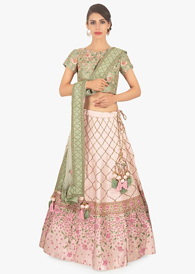 Sage Green Blouse With Floral Embroidery Paired With Creamish Pink Lehenga And Off White Net Dupatta Online - Kalki Fashion