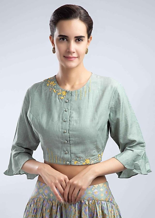 Sage green foil printed silk lehenga with matching floral embroidered blouse only on Kalki