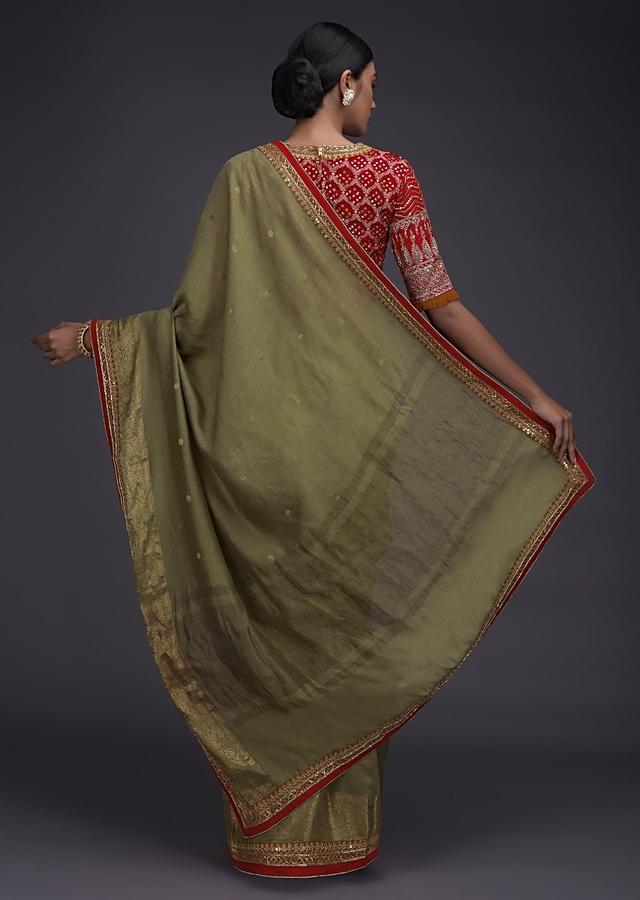 Sage Green Handloom Saree With Weaved Buttis And Border And Red Bandhani Printed Blouse Online - Kalki Fashion