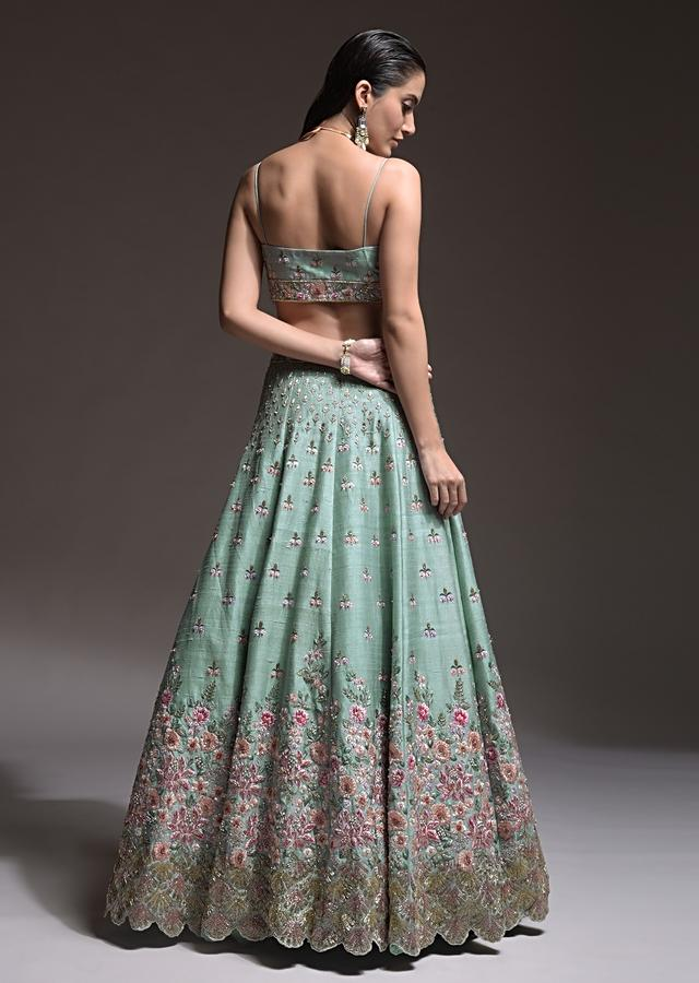 Sage Green Lehenga Choli In Raw Silk With Vibrant Resham Embroidered Cluster Of Summer Blooms And Buttis Online - Kalki Fashion