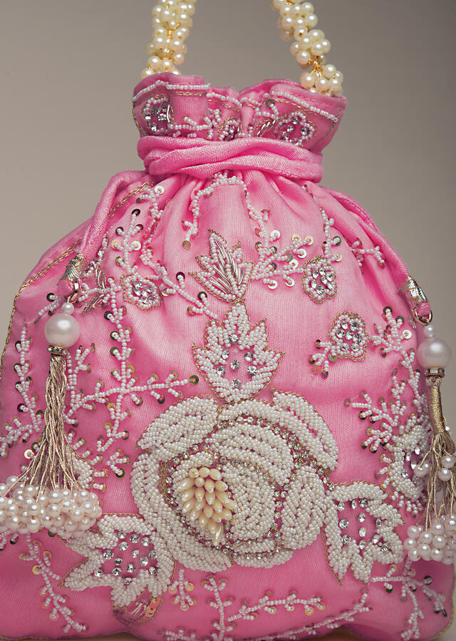 Salmon Pink Potli Bag In Raw Silk With Moti Embroidery In Rose Motif And Floral Design Online - Kalki Fashion