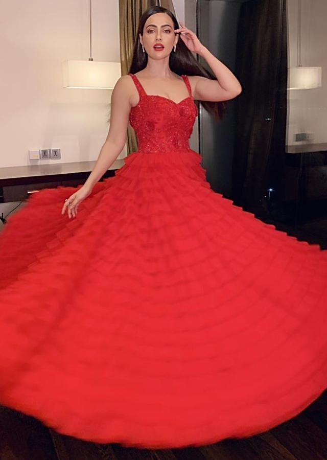Sana Khan in Kalki Cherry Red Sleeveless Gown In Hand Embroidered Bodice And Fancy Ruffle Layers